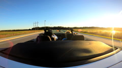 Stock Video Footage of Outdoors Driving Cabriolet Convertible Couple Ambition Open Top Transportation
