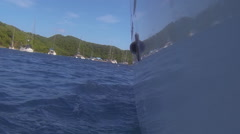 The side of sailboat sailing on the Caribbean sea Stock Footage