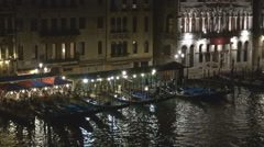 Aerial view famous gondola anchoring line Venice cityscape night tourism canal Stock Footage