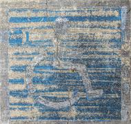 handicap wheelchair man symbol imprinted on a grungy pebble pavement - stock photo