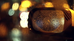 Rain and Street lights in LA - 50mm lens - rear view mirror with BOKEH - stock footage