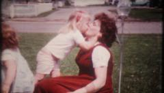 1359 - little girl has kisses for mom - vintage film home movie Stock Footage