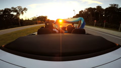 Stock Video Footage of Outdoors Driving Cabriolet Convertible Couple Ambition Open Top Sunset Fun