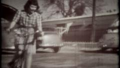 1362 - girl is riding the bicycle in parking lot - vintage film home movie Stock Footage