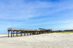 wooden pier at dauphin island - stock photo