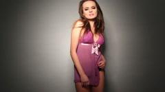 Seductive Woman in Purple Nighties Stock Footage