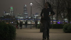 People in London at night Stock Footage