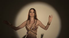 belly dancing on the spotlight - stock footage