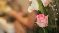 Close up rose bouquet flower arrangement Stock Footage
