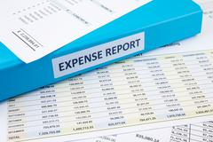 Business expense report with binder Stock Photos