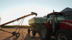 Auger filling grain cart with corn Stock Footage