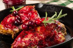 skillet with two glazed chicken breasts - stock photo