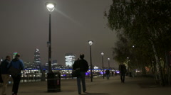 London skyline with people walking at night Stock Footage