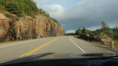 Driving in Northern Ontario. Evening sun on rockcut. Stock Footage