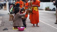 Buddhist Alms Giving Ceremony in Luang Prabang, Laos Stock Footage