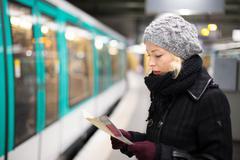 Lady waiting on subway station platform. Stock Photos