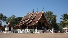 Tourists at Wat Xieng Thong (Golden City Temple) in Luang Prabang, Laos Stock Footage