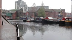 Wide Shot of Narrow Boats Docked in Canal Harbour Stock Footage