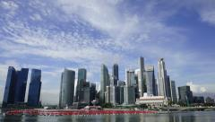Zooming in on Singapore CBD Landscape with moving clouds Stock Footage