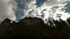 Timelapse of castle on a mountain with storm clouds Stock Footage