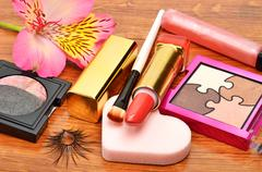 Decorative cosmetics and orchid flower Stock Photos