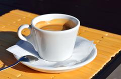 Cup of black aromatic coffee Stock Photos