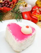 christmas delicious heart shaped cake with coconut chips on christmas backgro - stock photo
