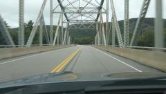 Driving across a truss bridge. Northern Ontario, Canada. - stock footage