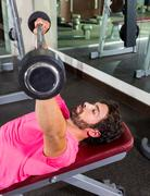barbell inclined bench press flyes man workout - stock photo