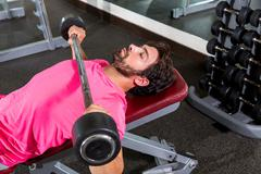Barbell inclined bench press flyes man workout Stock Photos