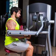 deltoids fly machine man for shoulders workout - stock photo