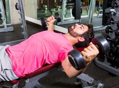 dumbbell incline bench flyes opening arms man - stock photo