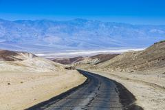 driving on the interstate 187 in death valley - stock photo
