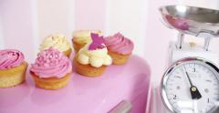 Beautifully decorated pink and white cupcakes Stock Footage