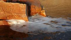 River Foam Under Rocks. Stock Footage