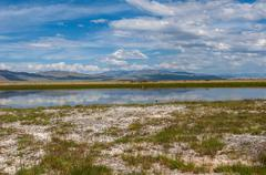 Lake steppe sky mountains clouds Stock Photos