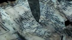 Knife on treasure map Stock Footage