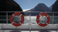 Rescue rings in the wind of Milford sound Stock Footage