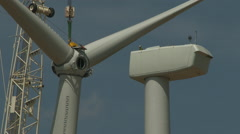 Wind turbine roter blades attached to nacelle Stock Footage