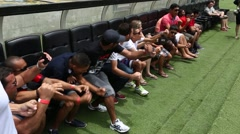 Group of people celebrating football game on the bench in Maracana, Brazil Stock Footage