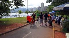 People Enjoying a Summer Day Doing Sports on Rodrigo de Freitas Lagoon Stock Footage