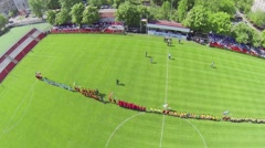 Formation of soccer teams on grass field during competition Stock Footage