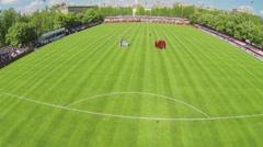 Teams prepare for game on football field of Spartakovec stadium Stock Footage