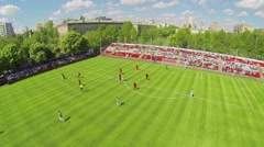 Young sportsmen play soccer on field of Spartakovec stadium Stock Footage