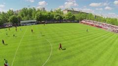 Football teams play on field of Spartakovec stadium Stock Footage