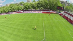 Player makes penalty strike near gate on soccer field Stock Footage