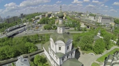 Cityscape with Spaso-Andronikov monastery and traffic on quay Stock Footage
