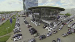 Cars parked near dealership of Mercedes-Benz company Stock Footage