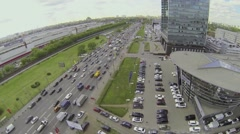 Traffic on highway near dealer center of Mercedes-Benz company Stock Footage