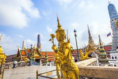 Stock Photo of a kinaree, a mythology figure, is watching the temple in the grand palace